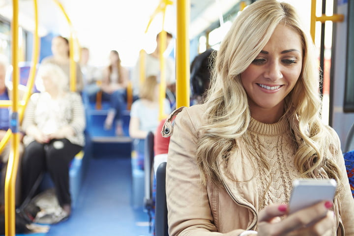 what is an rss feed 31019544  woman reading text message on bus