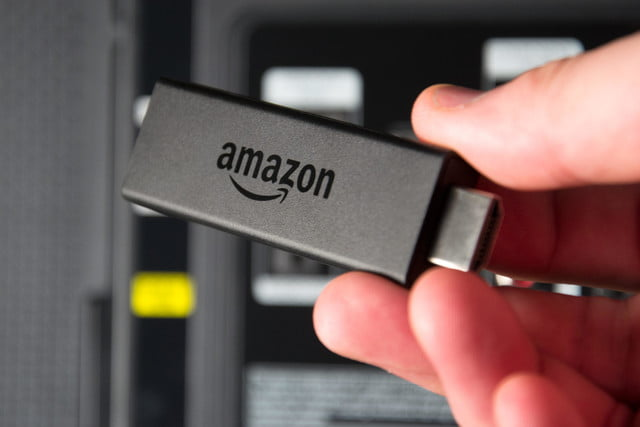 Amazon Fire TV Stick in hand