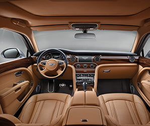 Screens and dials come and go, but for Bentley, wood will never die