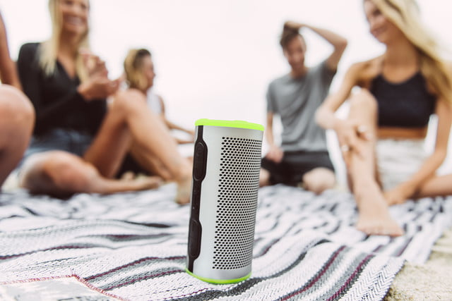 Stryde 360 speaker upright view surrounded by people listening