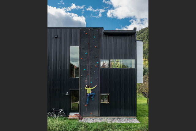 jackson hole area home features exterior rock climbing wall cache creek residence carney logan burke architects 005