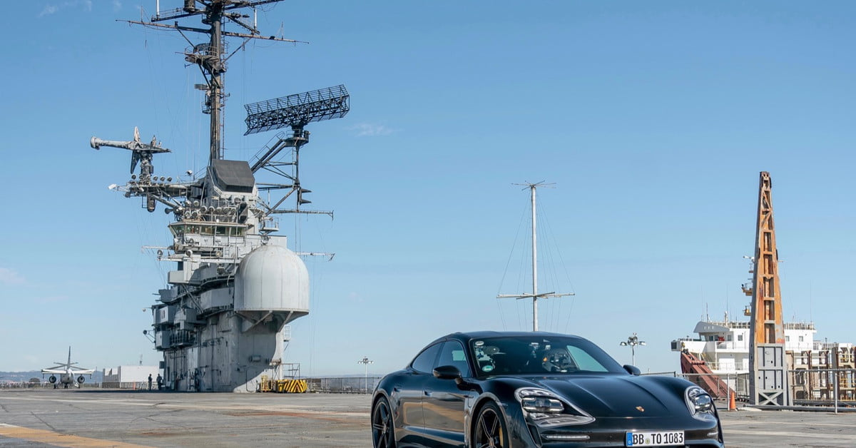 Watch a Porsche Taycan prototype hit 90 mph on the deck of an aircraft carrier