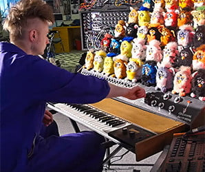 Feast your ears on the nightmarish melodies of this Furby-powered synth organ