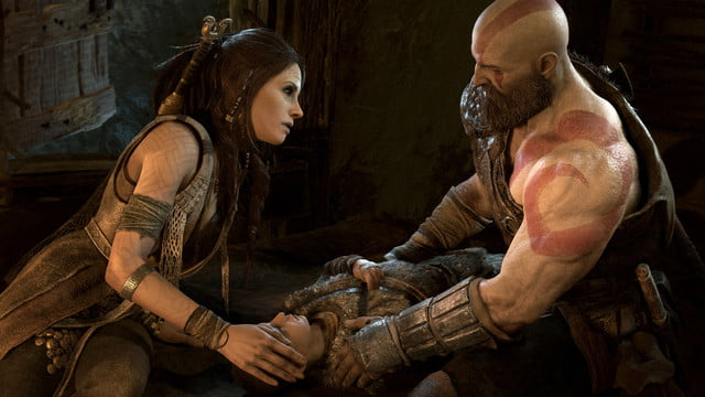 God of War Review | Kratos and an unknown woman caring for Atreus
