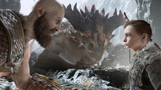 God of War Review | Kratos and Atreus having an emotional conversation in front of a large beast