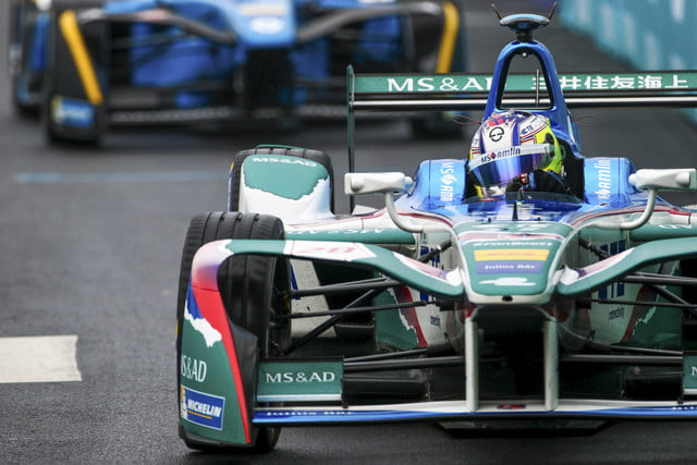 Formula E racer driving down the track in the NYC ePrix