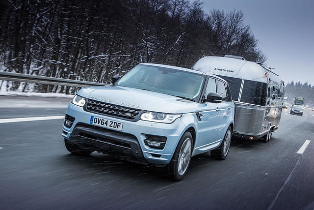 land rover range sport hybrid tows airstream to arctic circle  towing in snow