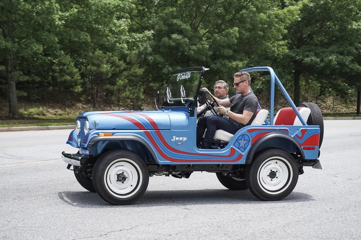 Side shot of blue with two red ribbon stripes classic jeep