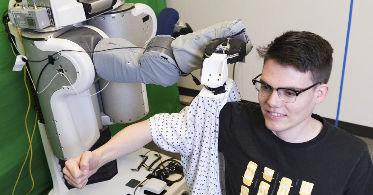 You won't even need to dress yourself in the future — thanks to robots like this