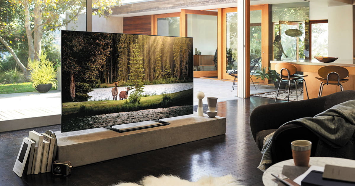 Qled vs oled tv what s the difference and why does it for Living room with 65 inch tv
