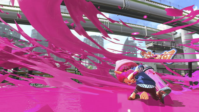 Splatoon 2 review character slamming onto the ground and generating a blast of paint