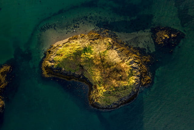 best drone photos top down view of an small island in scotland
