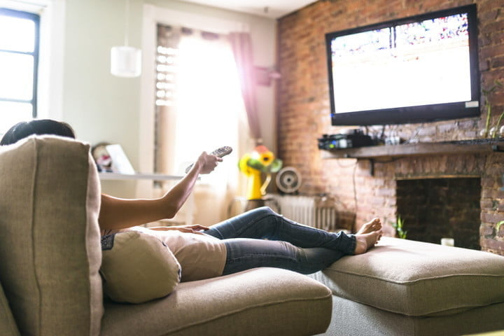 hdmi arc explained works care woman relaxing online on sofa reading some papers